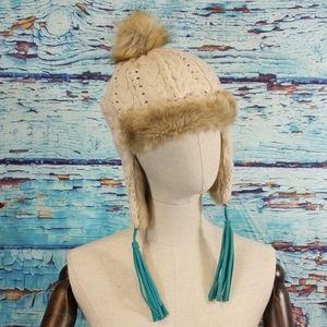 Pistil knitted pompom hat